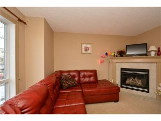 Photo 3: 202 ARBOUR MEADOWS Close NW in Calgary: Arbour Lake House for sale : MLS®# C4048885