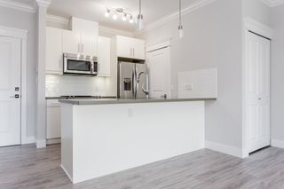"""Photo 2: 405 2229 ATKINS Avenue in Coquitlam: Central Pt Coquitlam Condo for sale in """"Downtown Pointe"""" (Port Coquitlam)  : MLS®# R2440972"""
