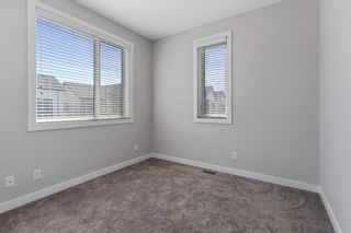 Photo 21: 903 Redstone Crescent NE in Calgary: Redstone Row/Townhouse for sale : MLS®# A1096519