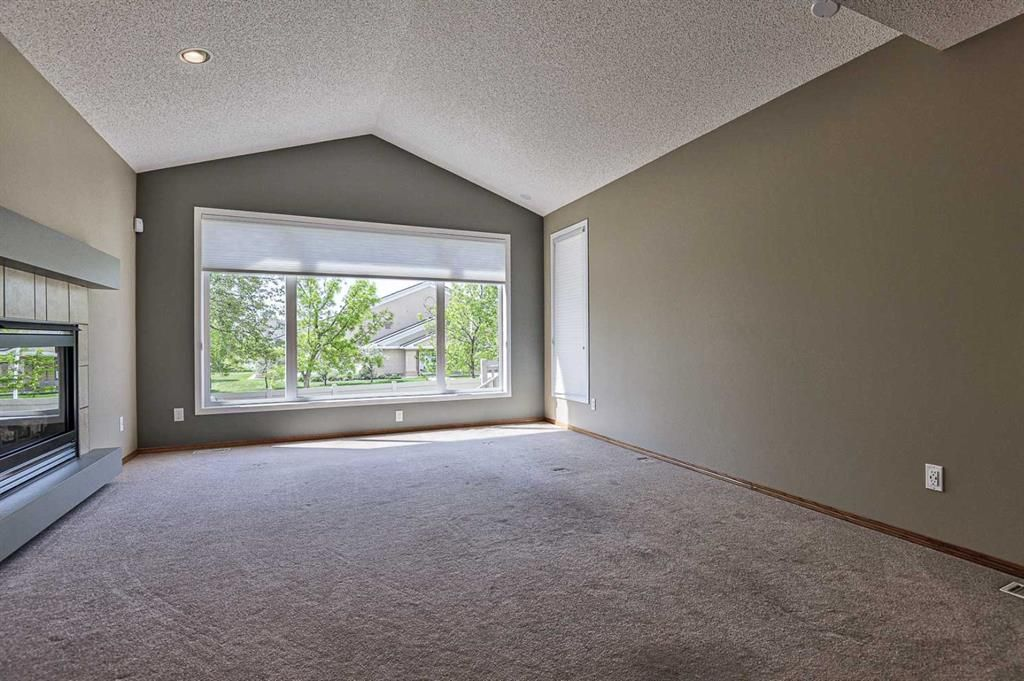 Photo 11: Photos: 106 Everwillow Close SW in Calgary: Evergreen Detached for sale : MLS®# A1116249