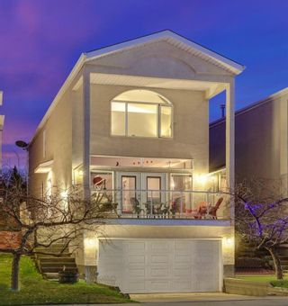 Photo 1: 5511 Strathcona Hill SW in Calgary: Strathcona Park Detached for sale