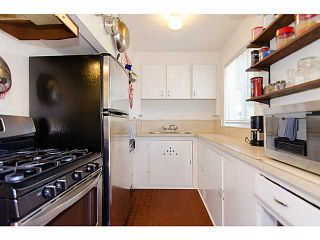 """Photo 5: 1616 SEMLIN Drive in Vancouver: Grandview VE House for sale in """"Commercial Drive"""" (Vancouver East)  : MLS®# V970626"""