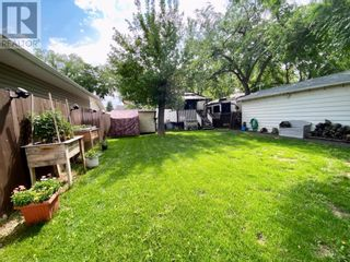Photo 9: 415 3A Street W in Brooks: House for sale : MLS®# A1129371