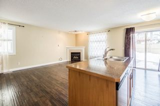 Photo 9: 23 TUSCARORA WY NW in Calgary: Tuscany House for sale : MLS®# C4174470