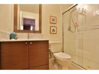 "Photo 10: 112 101 MORRISSEY Road in Port Moody: Port Moody Centre Condo for sale in ""LIBRA AT SUTER BROOK VILALGE"" : MLS®# R2010522"