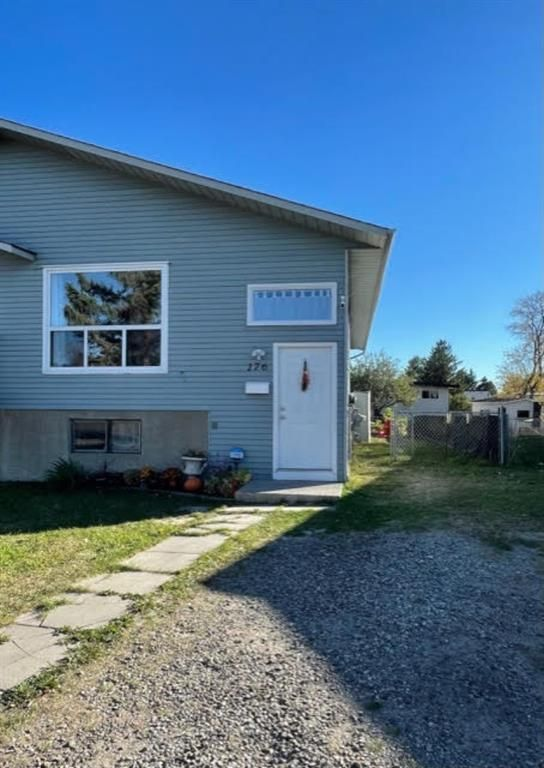 Main Photo: 176 FONDA Drive SE in Calgary: Forest Heights Semi Detached for sale : MLS®# A1152740