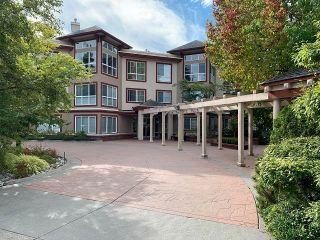 """Photo 1: 110 15342 20 Avenue in Surrey: King George Corridor Condo for sale in """"Sterling Place"""" (South Surrey White Rock)  : MLS®# R2617836"""