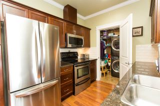 """Photo 10: 408 33338 MAYFAIR Avenue in Abbotsford: Central Abbotsford Condo for sale in """"The Sterling"""" : MLS®# R2456135"""