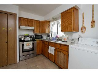 Photo 5: 7731 CANADA Way in Burnaby: Edmonds BE House for sale (Burnaby East)  : MLS®# V1075205
