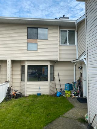 Photo 1: 4 3320 ULSTER Street in Port Coquitlam: Lincoln Park PQ Townhouse for sale : MLS®# R2624437