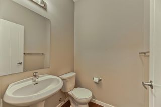 Photo 11: 539 Panatella Walk NW in Calgary: Panorama Hills Row/Townhouse for sale : MLS®# A1125854