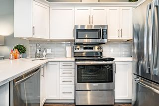 """Photo 17: #407 20200 56 Avenue in Langley: Langley City Condo for sale in """"The Bentley"""" : MLS®# R2598723"""
