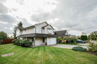 Photo 1: 19588 114B Avenue in Pitt Meadows: South Meadows House for sale : MLS®# R2566314