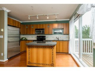 """Photo 7: 111 7179 201ST Street in Langley: Willoughby Heights Townhouse for sale in """"DENIM"""" : MLS®# F1447236"""