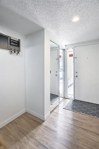 Photo 4: 104 2423 56 Street NE in Calgary: Pineridge Row/Townhouse for sale : MLS®# A1114587
