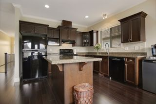 """Photo 5: 34906 2ND Avenue in Abbotsford: Poplar House for sale in """"Huntindgon Village"""" : MLS®# R2102845"""