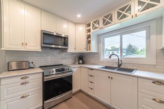 Photo 6: 2820 GRANT Crescent SW in Calgary: Glenbrook Detached for sale : MLS®# A1118320