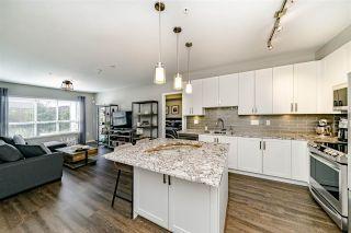 "Photo 7: 117 6490 194 Street in Surrey: Clayton Condo for sale in ""WATERSTONE - ESPLANADE"" (Cloverdale)  : MLS®# R2404179"