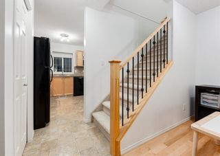 Photo 23: 218 950 ARBOUR LAKE Road NW in Calgary: Arbour Lake Row/Townhouse for sale : MLS®# A1136377