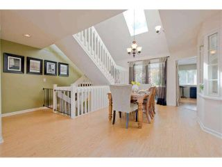 "Photo 1: 125 2721 ATLIN Place in Coquitlam: Coquitlam East Townhouse for sale in ""THE TERRACES"" : MLS®# V1057013"