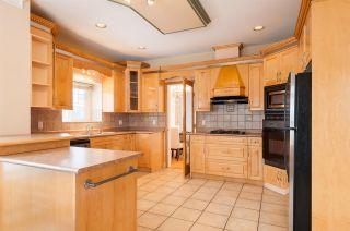 Photo 9: 5867 138 Street in Surrey: Panorama Ridge House for sale : MLS®# R2540887