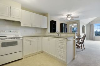 """Photo 5: 416 960 LYNN VALLEY Road in North Vancouver: Lynn Valley Condo for sale in """"Balmoral House"""" : MLS®# R2162251"""