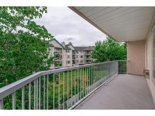 """Photo 19: 208 5375 205 Street in Langley: Langley City Condo for sale in """"GLENMONT PARK"""" : MLS®# R2295267"""