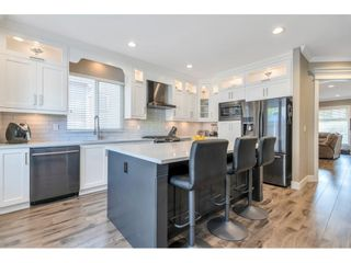 """Photo 2: 18883 71 Avenue in Surrey: Clayton House for sale in """"Clayton"""" (Cloverdale)  : MLS®# R2621730"""