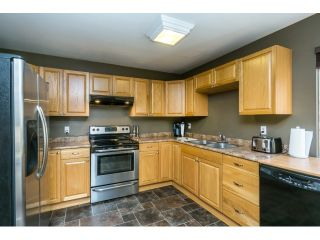 """Photo 12: 106 2844 273 Street in Langley: Aldergrove Langley Townhouse for sale in """"Chelsea Court"""" : MLS®# R2039587"""