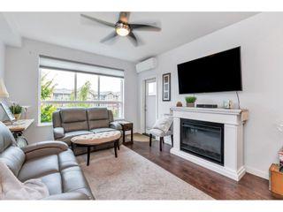 "Photo 7: 201 6480 194 Street in Surrey: Clayton Condo for sale in ""Waterstone - Esplande"" (Cloverdale)  : MLS®# R2509715"
