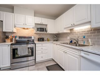 "Photo 1: 312 9650 148 Street in Surrey: Guildford Condo for sale in ""Hartford Woods"" (North Surrey)  : MLS®# R2476234"