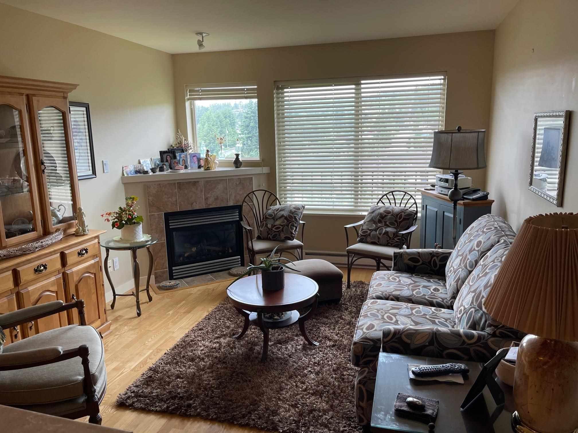Main Photo: 407 5631 INLET Avenue in Sechelt: Sechelt District Condo for sale (Sunshine Coast)  : MLS®# R2596282