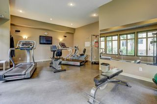 Photo 29: 1302 92 Crystal Shores Road: Okotoks Apartment for sale : MLS®# A1132113