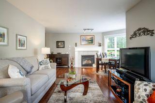 Photo 10: 102 3172 GLADWIN ROAD in Abbotsford: Central Abbotsford Condo for sale : MLS®# R2595337