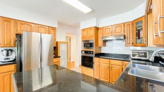Photo 7: 879 W 60TH Avenue in Vancouver: Marpole House for sale (Vancouver West)  : MLS®# R2606107