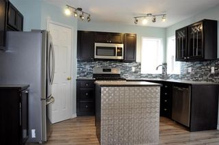 Photo 6: 8 WOODSIDE Circle NW: Airdrie House for sale : MLS®# C4130455