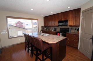 Photo 9: 151 Silverado Drive SW in Calgary: Silverado Detached for sale : MLS®# A1124527