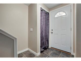 Photo 2: 24 WOODHILL Road SW in Calgary: Woodlands House for sale : MLS®# C4109351