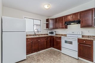 Photo 2: 5607 4 Street SW in Calgary: Windsor Park Semi Detached for sale : MLS®# A1106549
