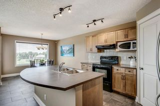 Photo 8: 87 TUSCANY RIDGE Terrace NW in Calgary: Tuscany Detached for sale : MLS®# A1019295