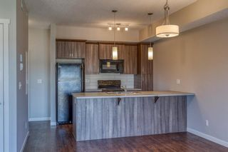 Photo 10: 9308 101 Sunset Drive: Cochrane Apartment for sale : MLS®# A1079009