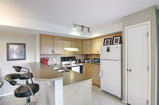 Photo 12: 204 300 Edwards Way NW: Airdrie Apartment for sale : MLS®# A1111430