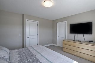 Photo 32: 144 Heartland Way: Cochrane Detached for sale : MLS®# A1098952