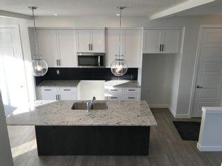 Photo 10: 11 Sundown Manor: Cochrane Semi Detached for sale : MLS®# A1071566