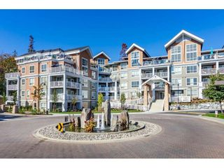 """Photo 1: 303 6490 194 Street in Surrey: Cloverdale BC Condo for sale in """"WATERSTONE"""" (Cloverdale)  : MLS®# R2489141"""