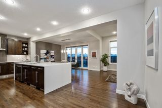 Photo 4: 204 ASCOT Crescent SW in Calgary: Aspen Woods Detached for sale : MLS®# A1025178