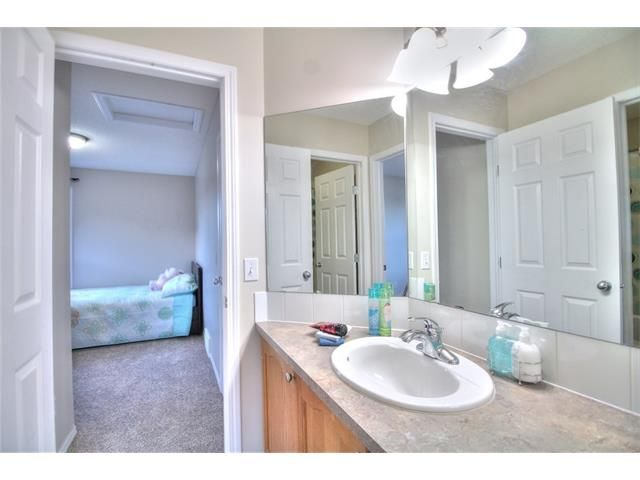 Photo 27: Photos: 606 EVERMEADOW Road SW in Calgary: Evergreen House for sale : MLS®# C4053479