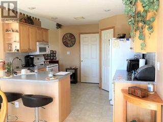 Photo 2: 907 2 Avenue  W in Brooks: House for sale : MLS®# A1115506
