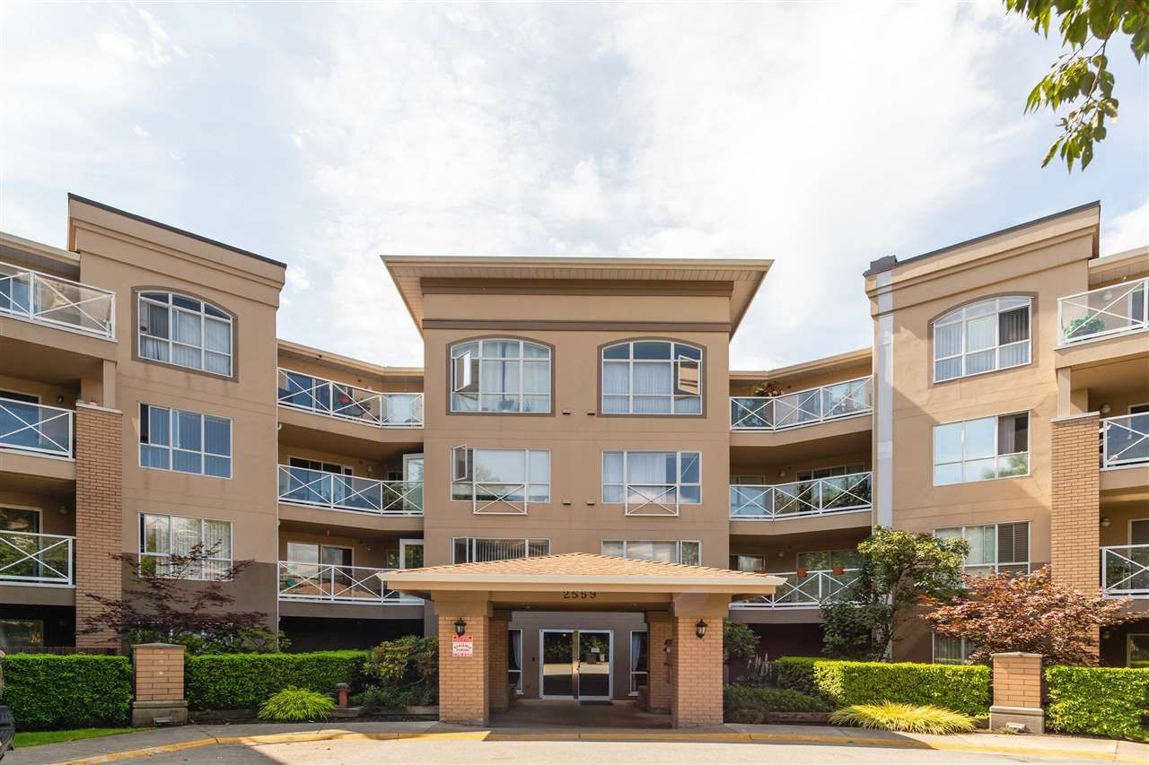 """Main Photo: 111 2559 PARKVIEW Lane in Port Coquitlam: Central Pt Coquitlam Condo for sale in """"THE CRESCENT"""" : MLS®# R2486202"""