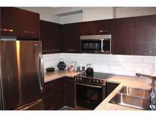 "Photo 2: 101 2957 GLEN Drive in Coquitlam: North Coquitlam Condo for sale in ""RESIDENCES AT THE PARC"" : MLS®# V918972"